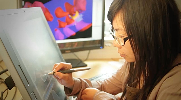 Researcher Donglei Chen using computer with stylus pen.