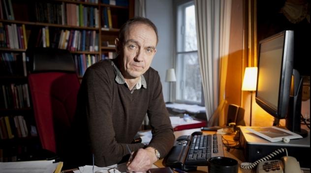 Personporträtt på Torsten Svensson fotograferat på tjänsterummet.