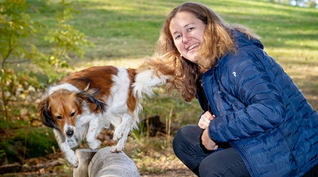 Tove Fall playing with her dog.
