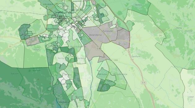 Karta över Uppsala där olika stadsdelar har olika nyanser av grått och grönt.
