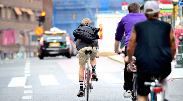Cyclists on the road in city traffic.
