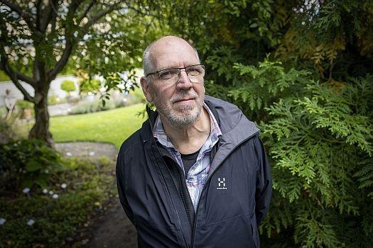 Man in front of garden