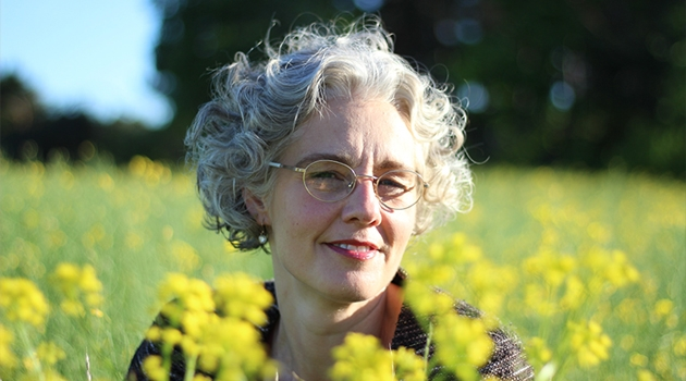 Picture of Liselott in a field of canola.