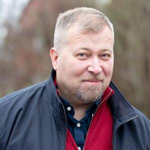 Porträttbild av Olle Lundin.