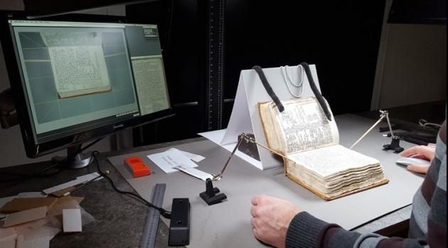 a medieval manuscript is being digitised