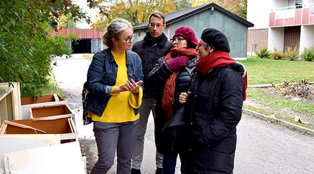 Raquel Rolnik tillsammans med tre personer.
