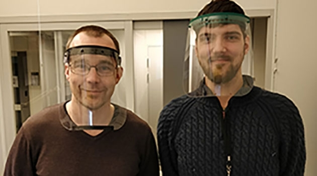 Johan Kreuger and Adam Engberg in 3D-printed protective face shields.