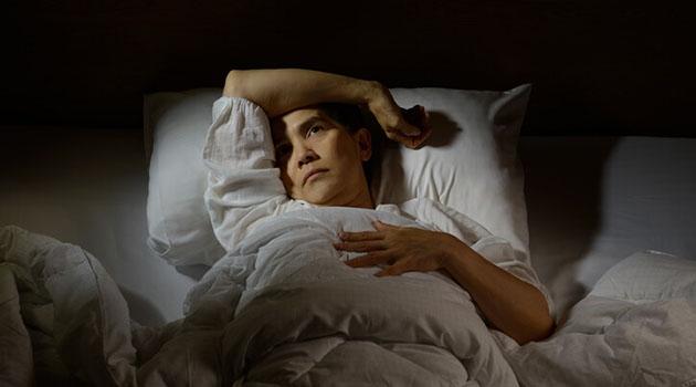 Kvinna med sömnsvårigheter
