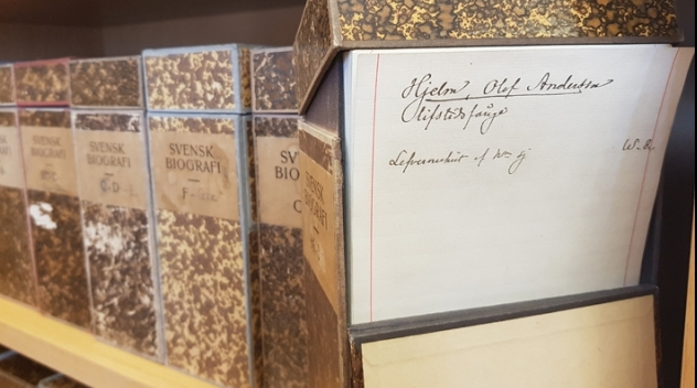 a row of catalogue boxes, one is open and shows a handwritten catalogue card
