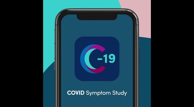 Mobiltelefon med logotyp för COVID Symptom Study synlig på skärmen.