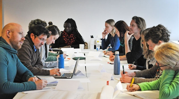 A group of students sitting at a table.